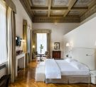 Bedroom of the Da Verrazzano Suite of the Relais Santa Croce in Florence