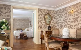 Bedroom and living room of the1-Bedroom Suite of Baglioni Hotel Luna in Venice