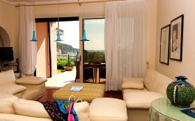 Living room and terrace of the Family  Suite of the Baglioni Resort Cala del Porto in Punta Ala